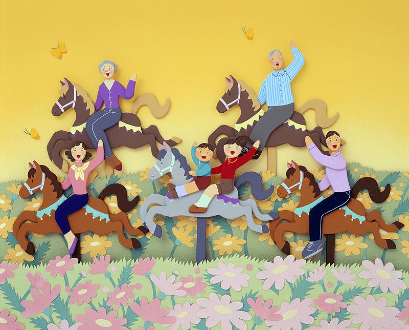 秦紀子 春の花畑でメリーゴーランドの木馬に乗って笑顔の家族イラスト 家族・ファミリーイラスト