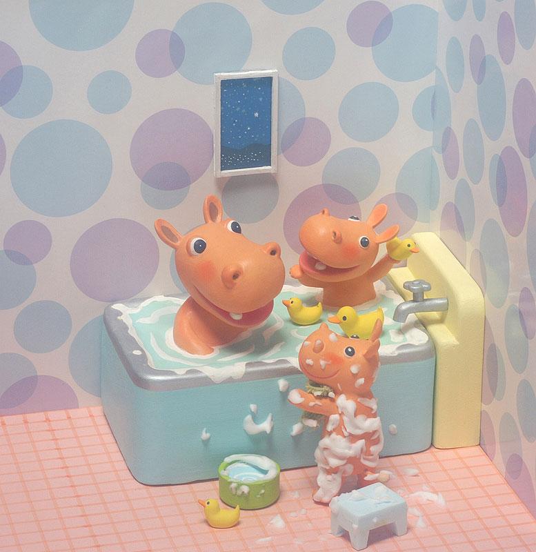 お風呂に入るカバの家族のイラスト